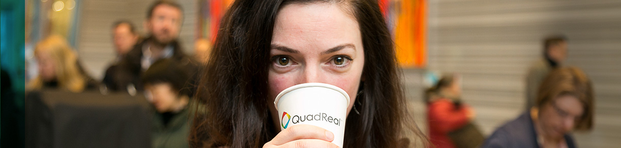 Women drinking QuadReal Cup close up