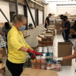 People unpacking food donations