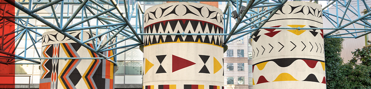 Header banner - three pillars with mural artwork