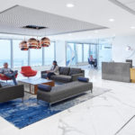 People sitting in office lobby interior